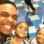 Photo of Darius Dennis with his two daughters